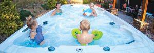 Family in Swim Spa Banner